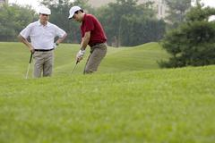 Stock Photo of Two Golfers on the Course