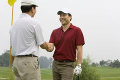 Stock Photo of Two Golfers shaking hands on the course