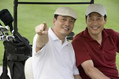 Two Golfers in the golf cart - stock photo