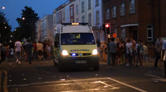 Ambulance Driving Through Crowd Stock Footage