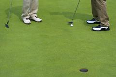 Close-up of two golfers Stock Photos