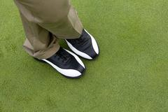 Close-up of golfer's feet Stock Photos
