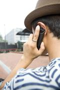 Stock Photo of Young man using cell phone
