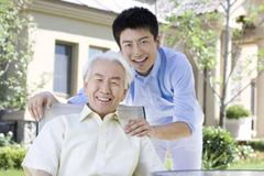 Stock Photo of Portrait of father and son