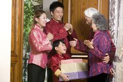 Family sending Chinese New Year gifts - stock photo