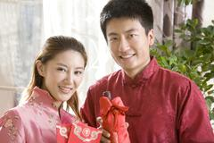 Portrait of young couple in Chinese New Year Stock Photos