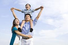 Portrait of a family of three Stock Photos