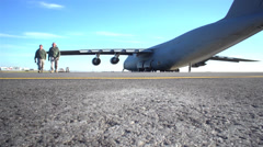 Pilots walk away from their C-5 Galaxy Stock Footage