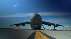 Raising the front cargo door on a C-5 Galaxy Stock Footage