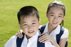 Elementary school students in the park - stock photo