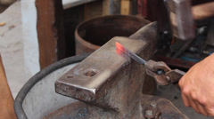 Team of blacksmiths forges a horseshoe Stock Footage