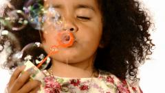 Funny  brazilian little girl isolated blowing soap bubbles Stock Footage