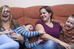 Happy women with children Stock Photos