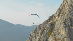 Paraglider flying close to ridge HD Stock Footage