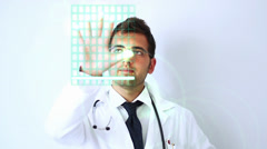 MEDICAL SCIENCE DOCTOR ACTIVATING A TOUCHSCREEN INTERFACE Stock Footage