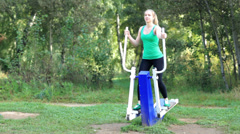 Woman exercising on a trainer Stock Footage