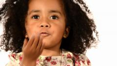 Funny mixed race black and latino brazilian little girl isolated Stock Footage
