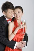Young couple in evening wear Stock Photos