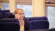 Stock Video Footage of Woman talking on the phone being on the train.