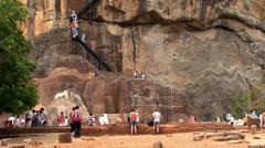 Tourists at the Lion Gate of Sigiriya. Sri Lanka. - stock footage