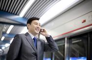 Stock Photo of Commuter on the phone
