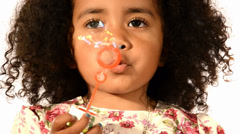 Nice child and soap bubbles Stock Footage