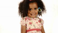 Funny mixed race black and brazilian little girl isolated with bubbles floating Stock Footage