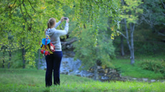 Woman taking pictures of nature scenes. Stock Footage
