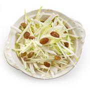 fresh apple salad with raisins and chicory - stock photo