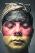 Woman with flag of germany on face and closed eyes Stock Photos