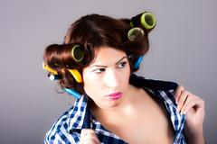 Housewife with curlers Stock Photos