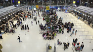 Stock Video Footage of fast moving crowd of people, at Suvarnabhumi airport, Thailand