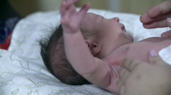 Close shot of a little baby moving his arms around Stock Footage