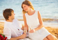 honeymoon concept, man and woman in love, couple enjoying glass of champagne  - stock photo
