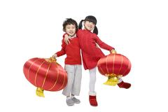 Kids celebrating Chinese New Years - stock photo