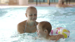 Little child having swimming lessons Stock Footage