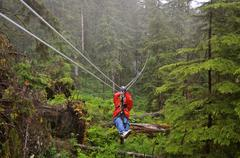 Zip lining through ketchikan Stock Photos