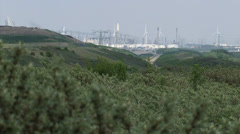 View from nature reserve Voorne Dunes at industrial area Maasvlakte Stock Footage