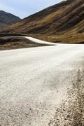 Road going through wilderness area into Qilian Mountain in Qinghai province, Stock Photos