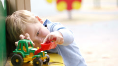 Boy playing with toy outdoor. Stock Footage