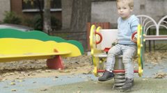 Little boy on the playground. Stock Footage