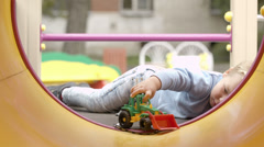 Little boy playing with toy. Stock Footage