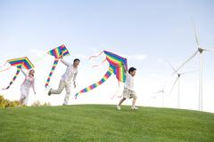 Family with windmill - stock photo