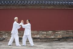 Senior Couple Practicing Tai Chi, Temple of Heaven Stock Photos