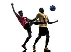 Two men soccer player  standing silhouette Stock Photos