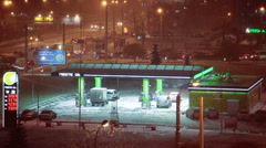 Petrol station of Neste oil Company in city at night with snowfall. Timelapse Stock Footage