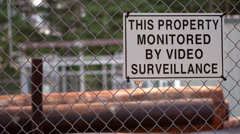 This property monitored by video surveillance sign - stock footage