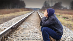 Depressed boy on the railway episode 2 Stock Footage
