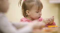 Little girl in the nursery. Stock Footage