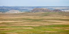 Stock Photo of panorama of grassland and badlands